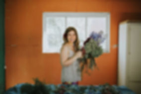happy woman holding flowers