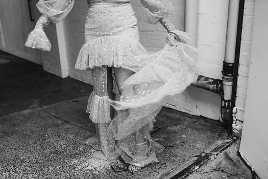 black and white image, woman twirls with her skirt