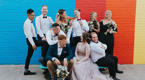 wedding party of 10 smile and laugh together