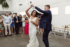couple twirls while dancing