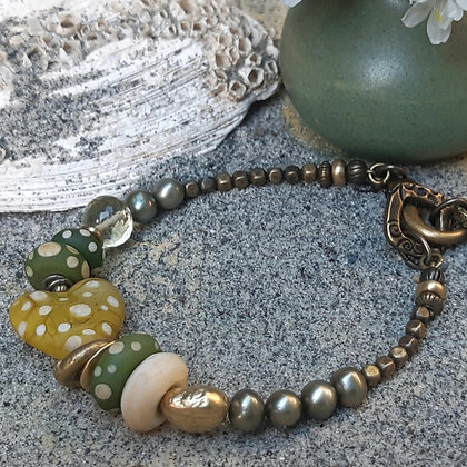 faded and beautiful - green and ivory bracelet