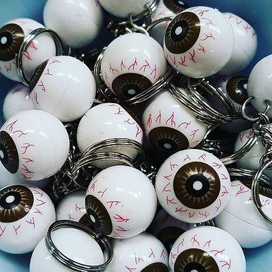 A bunch of eyeball keychains