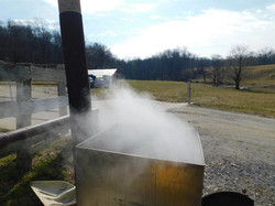 Boiling down the maple sap