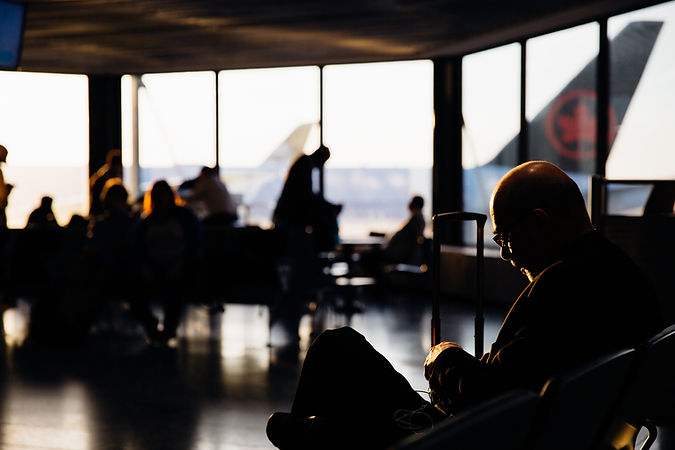 silhouette-of-people-sitting-waiting-to-