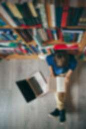 Top view, boy reading a opened book in l