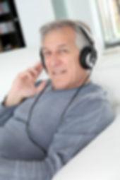 Senior man listening to music with headp