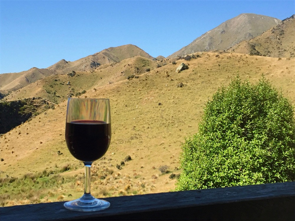 View from Cregan Hut ; Glas of Red wine