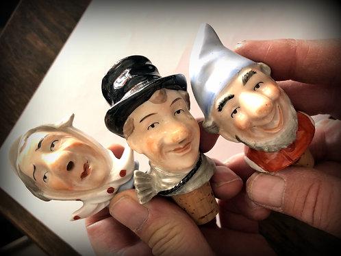Trije keramični zamaški za steklenico – glave