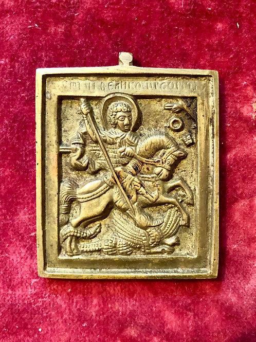 Potovalna kovinska ikona (sv. Jurij ubija zmaja)