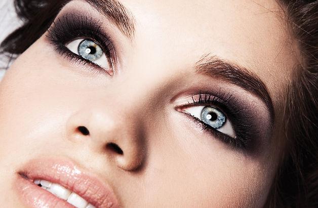 Beauty face makeup. Make up. Eyelashes e