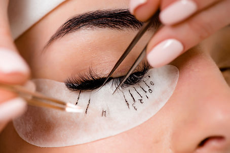 Eyelash extension procedure close up. Be