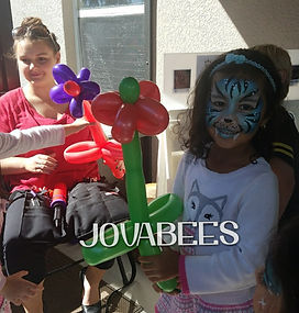JOVABEES Flower Balloon Twisting and Blue Tiger Face Painting