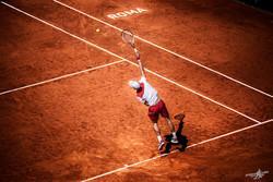 Novak serves