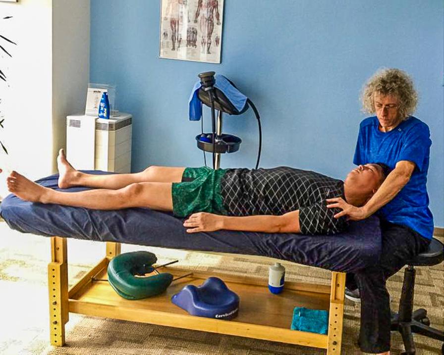 Chris Watts stretching and aligning Jonathon Hui