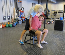 CrossFit Asphodel, working the lateral spinal flexors on