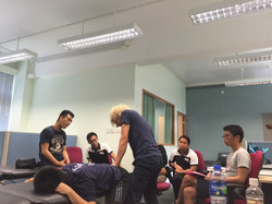 Assisted Illiacus stretch for corrective postural balancing