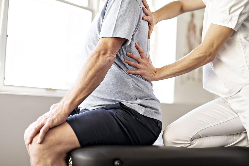 Physiotherapist-treating-back-pain.jpg