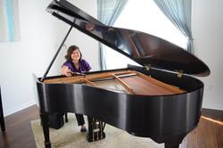 Michelle Lamm tuning the piano