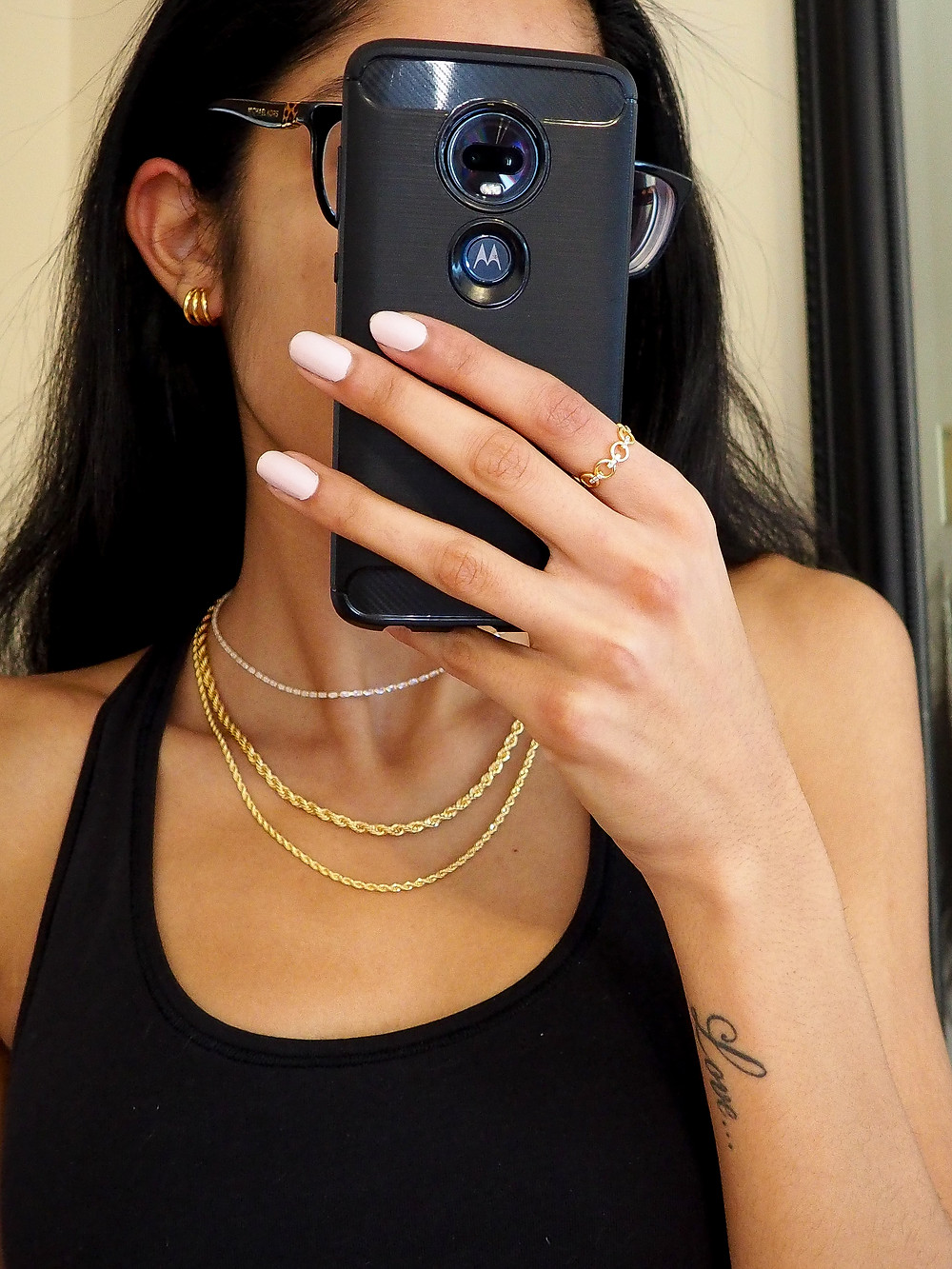 gold chains, gold hoop earrings and chain rings