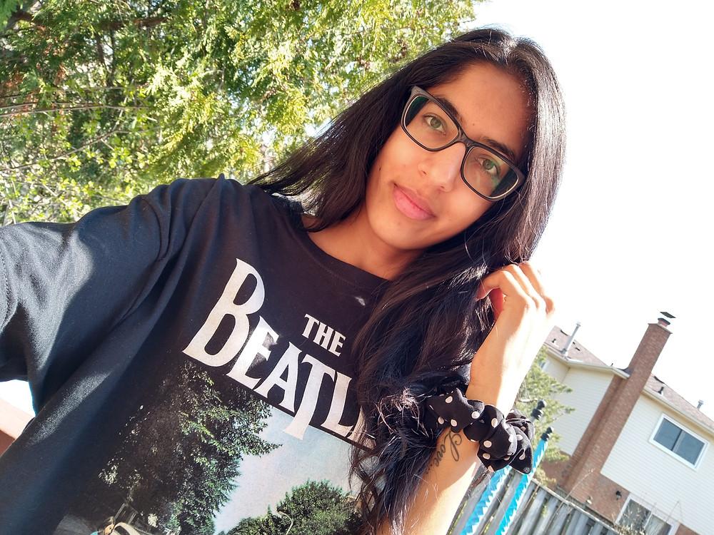 woman wearing beatles tshirt