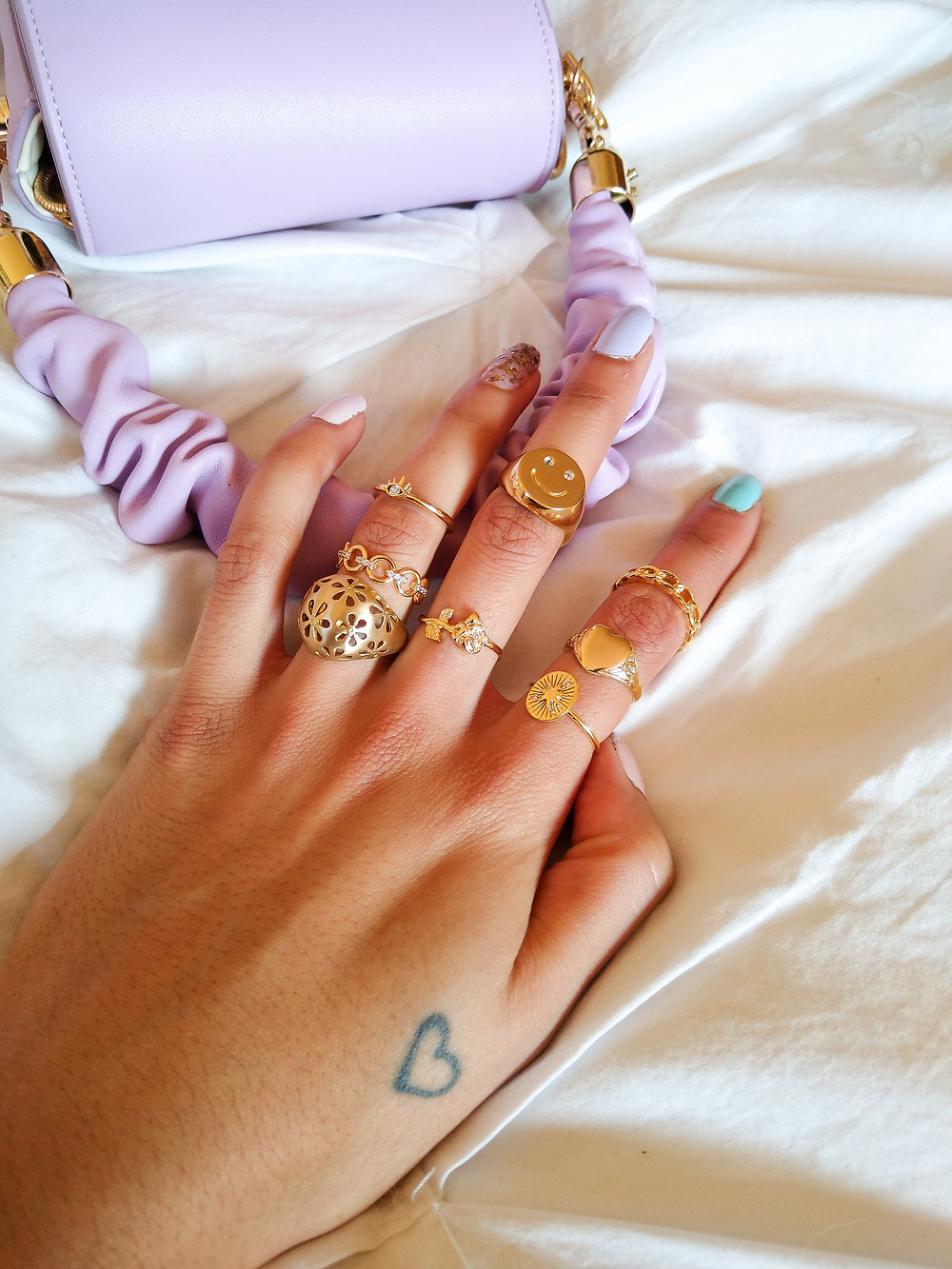 gold rings with purple bag
