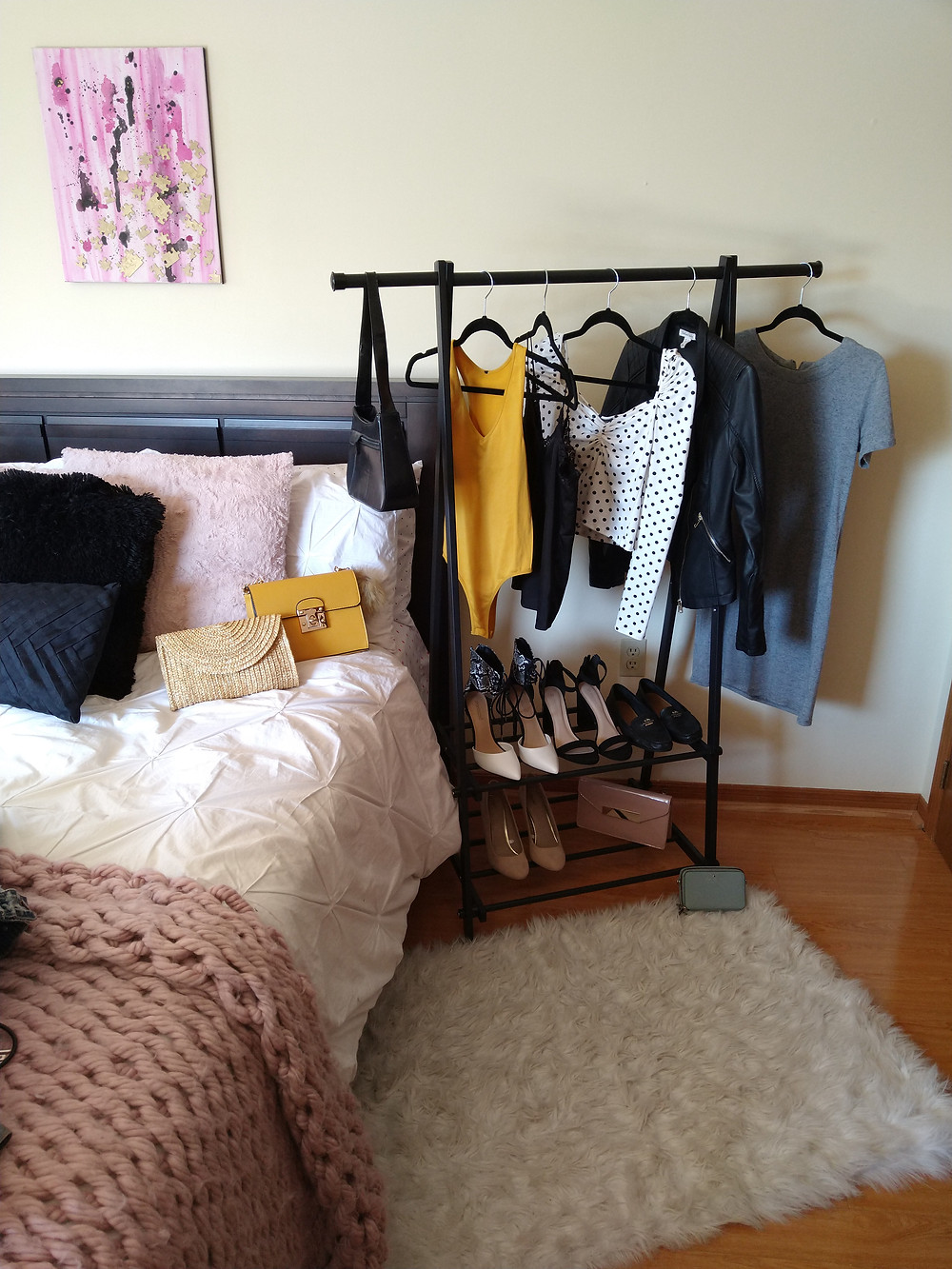 iron clothing rack with clothing on it