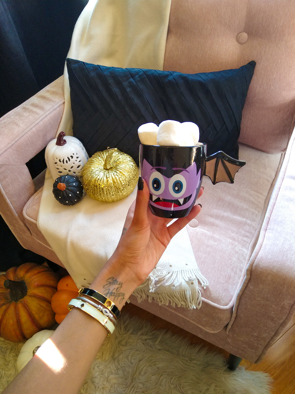 halloween mug with hot chocolate and fall decor