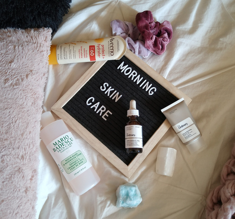 skin care products on a bed
