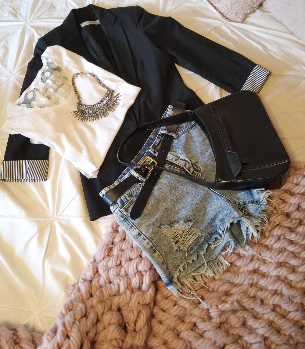 flatlay of fashion items. shoes bags, blazer and white top and shorts