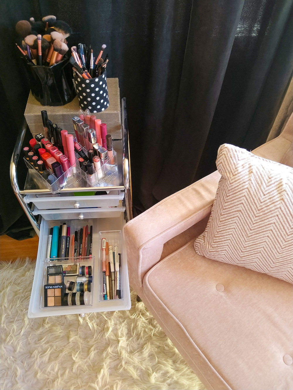 makeup storage and pink accent chair