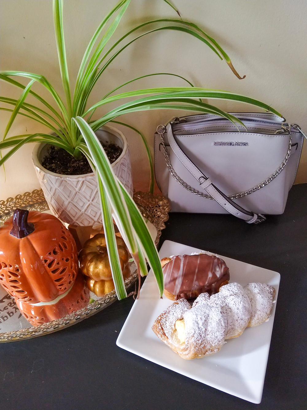 micheal kors bag with fall decor and pastries