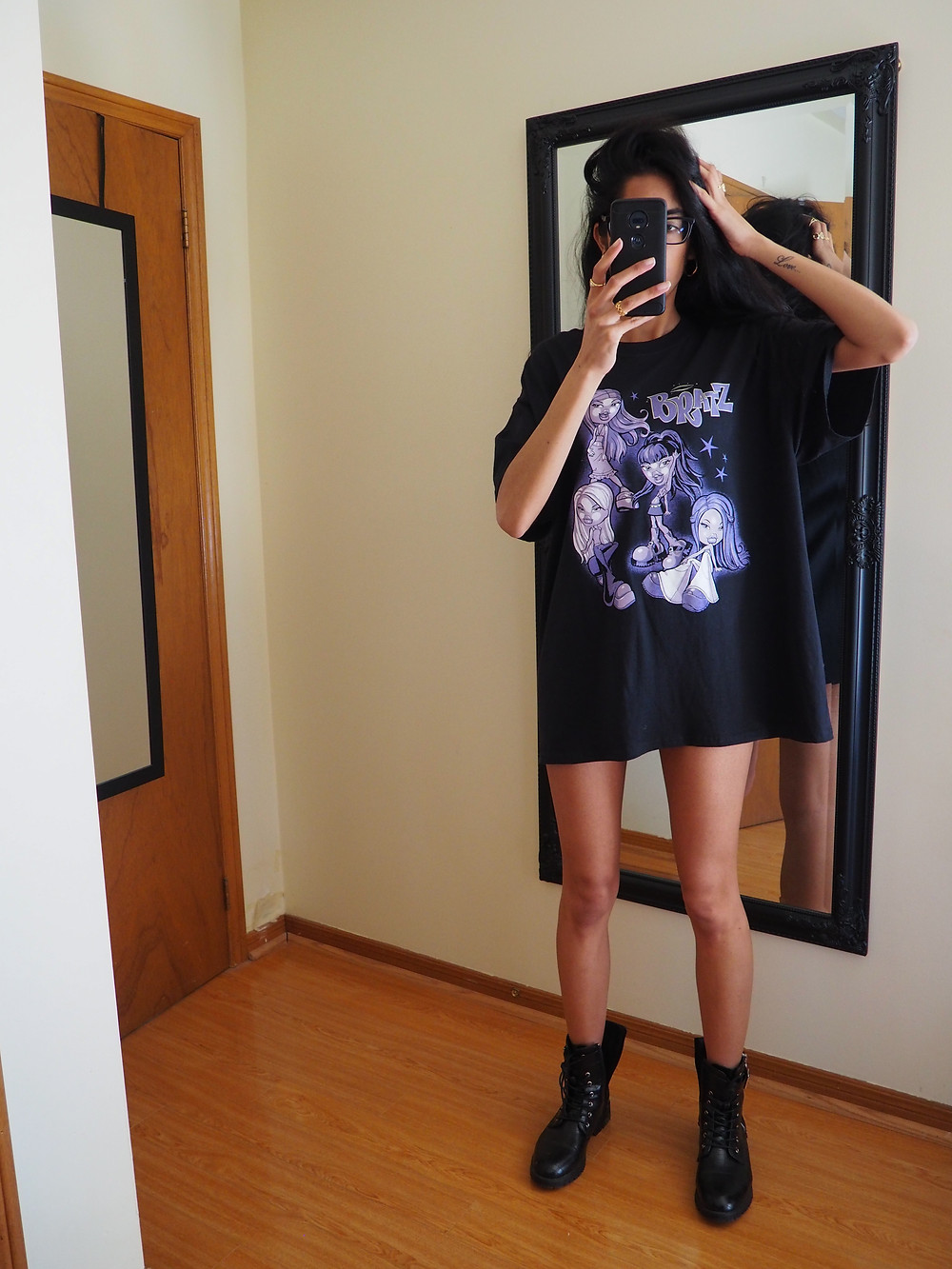 woman wearing a shirt and boots only