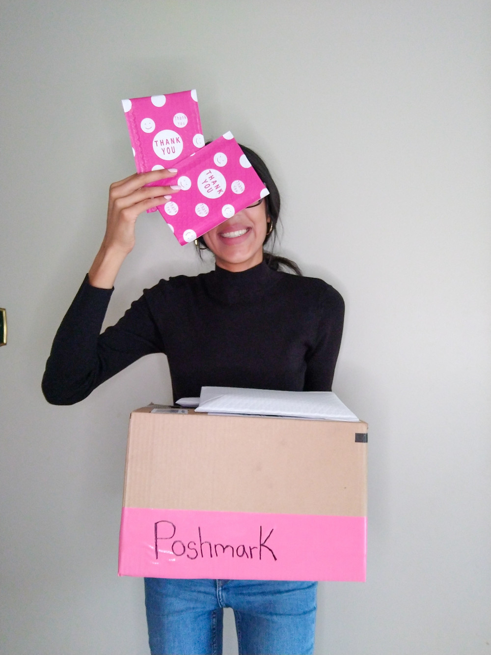 woman holding boxes of online orders