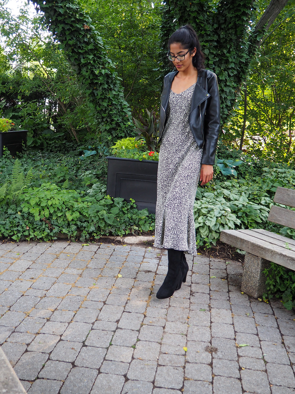 woman wearing leather jacket dress and knee high boots