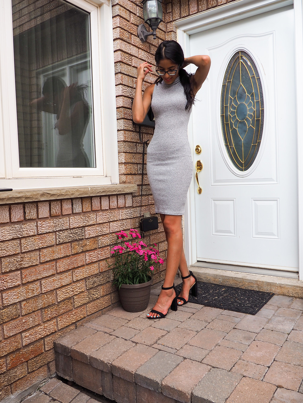 woman leaving her home in dress that is grey and tight