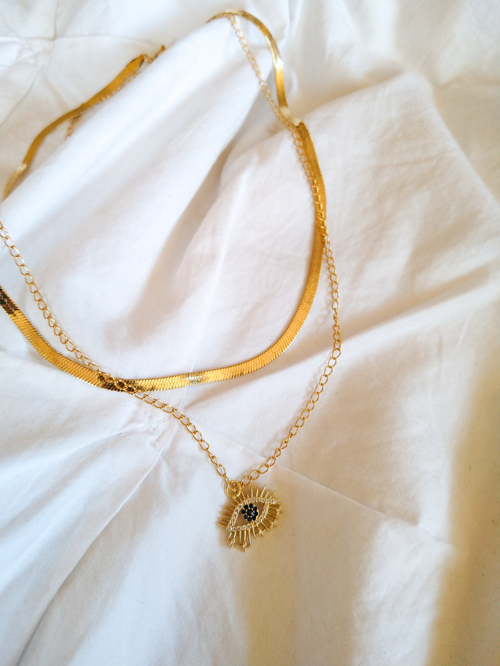 snake chain and evil eye necklace