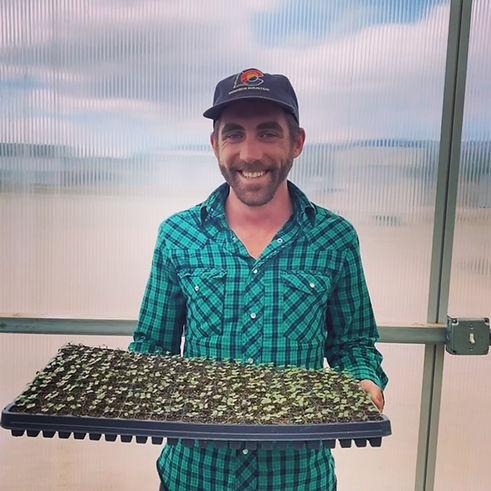 TJ in Greenhouse with seedlings 2019.JPG