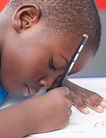 the-boy-writing-in-his-notebook_rsfxf6RI