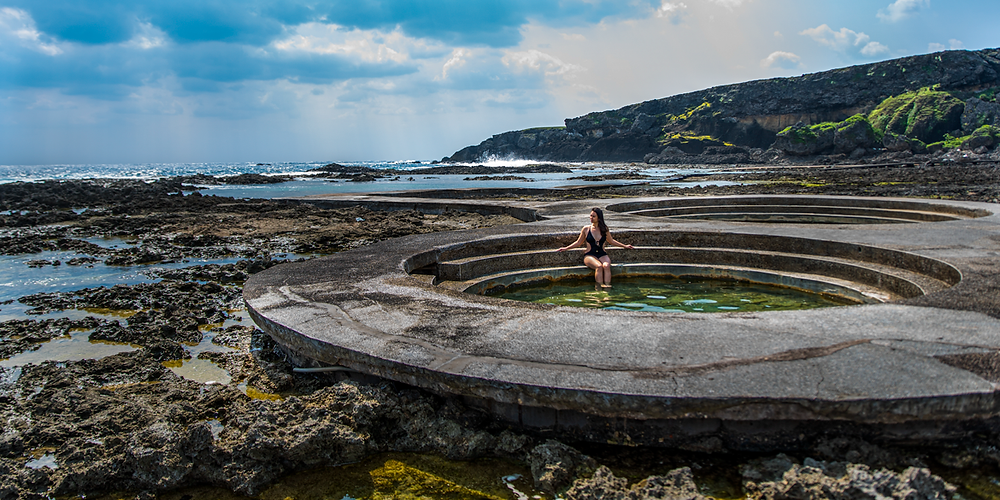 1 of 3 of Green Island's open-air circular baths close to the sea, filled with a mixture of seawater and underground sulfuric water heated by the magma deep under the island