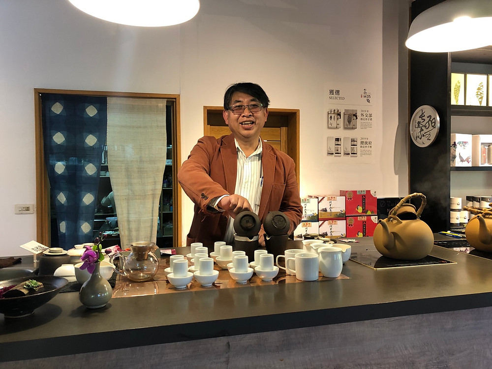 Mr. Wu Chih-Ching, the founder of Mountain Ali Tea No. 35, brews tea for his guests