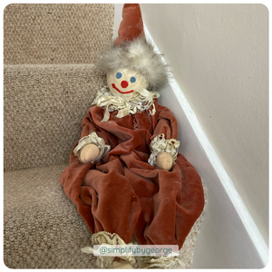picture of clown on stairs