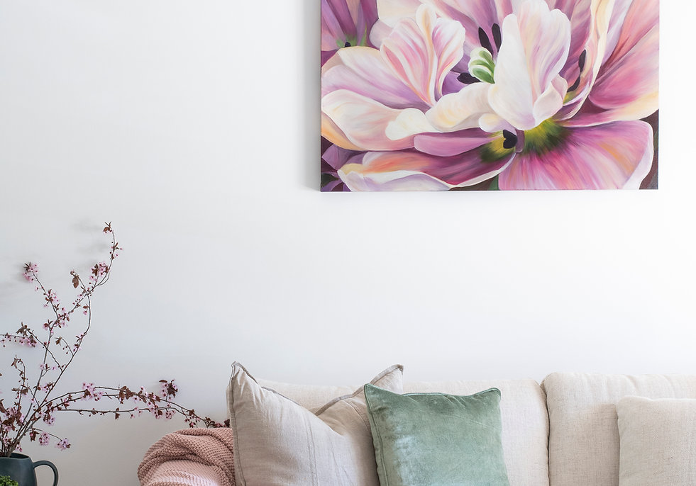 Macro tulip painting, pinks, greens, in styled interior setting.