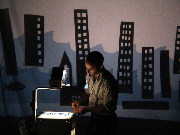 Matthew Robins performing shadow puppetry