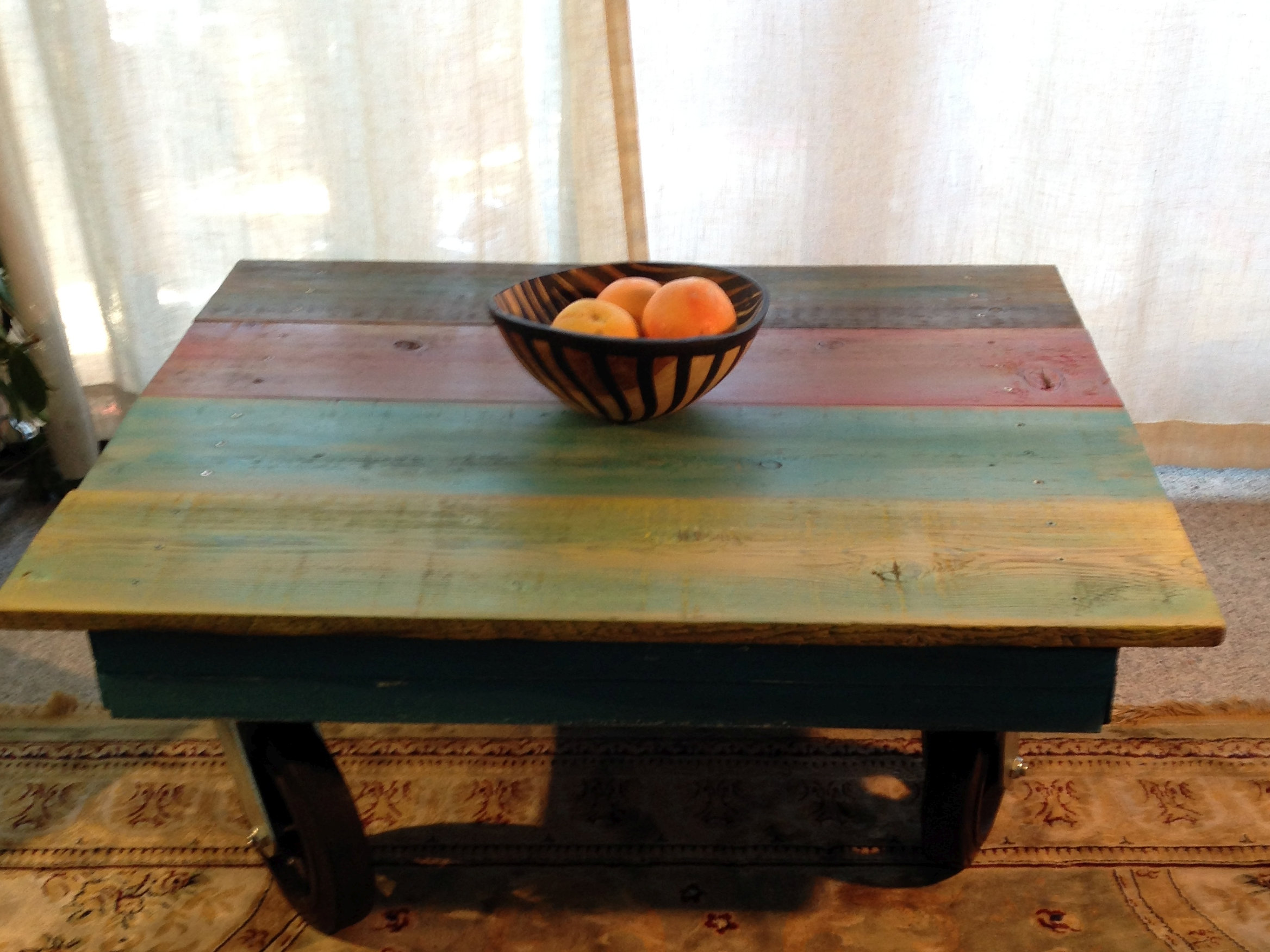 rehabitatzz reclaimed wood coffee table with big wheels
