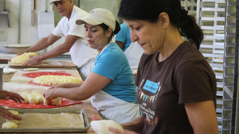Amy baking bread with her Amy's Bread team