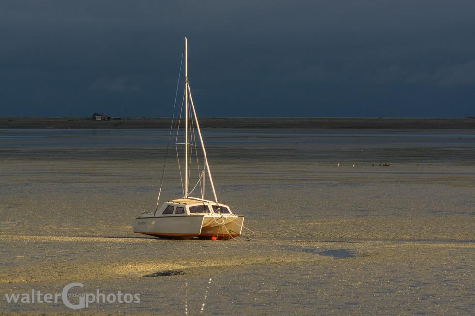 Sunrise on beached boat, Nelson, SI, New Zealand