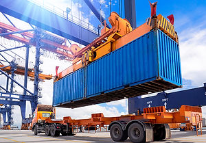 Container being loaded onto truck at por