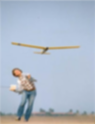 Man throwing glider in air