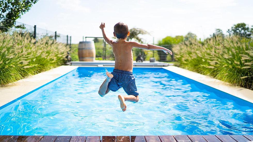 kid jumpin in pool.jpg