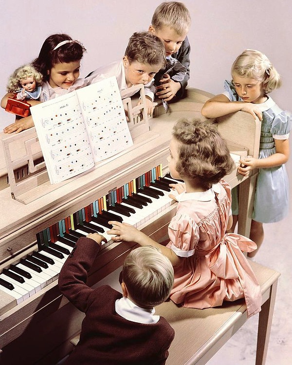 a-group-of-children-at-the-piano-herbert